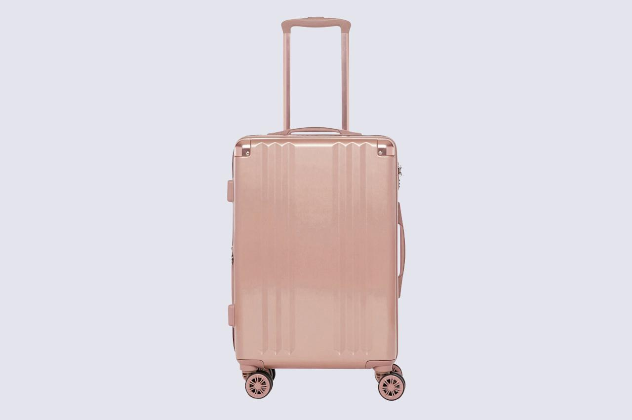 """<p>Nothing is worse than lugging a heavy carry-on through the airport. That's why it's important to pick out a piece with rotating wheels. This option features wheels with a 360-degree spin functionality; they also come in rose gold, gold, and silver finishes for added sophistication.</p> <p><strong><em>Shop Now: </em></strong><em>Calpak Ambeur Carry-On Luggage, $165, <a href=""""https://www.pntrac.com/t/8-12328-131940-196106?sid=MSL%2CTheBestCarry-OnLuggageforAnyTypeofTraveler%2Cgrello2%2CTra%2CGal%2C7614996%2C202002%2CI&#038;url=https%3A%2F%2Fwww.calpaktravel.com%2Fproducts%2Fambeur-carry-on-luggage"""" data-ecommerce=""""true"""" target=""""_blank"""" rel=""""nofollow"""" data-tracking-affiliate-name=""""www.calpaktravel.com"""" data-tracking-affiliate-link-text=""""calpaktravel.com"""" data-tracking-affiliate-link-url=""""https://www.calpaktravel.com/products/ambeur-carry-on-luggage"""" data-tracking-affiliate-network-name=""""Pepperjam"""">calpaktravel.com</a></em><em>.</em></p>"""