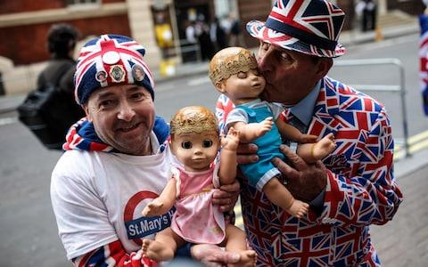 Royal fans John Loughrey (left) and Terry Hutt (right) pose with baby dolls outside the Lindo Wing of St Mary's Hospital ahead of the birth of the Duke and Duchess of Cambridge's third child on April 23, 2018 in London - Credit: Jack Taylor/Getty