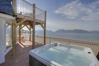 """<p>Looking for a beach house rental with a hot tub? Try this one with lake views in Glencoe. A villa with wonderful spaces to dine and relax together, the self-catering pad comes with access to a restaurant, 24-hour front desk and bar. There's a garden and terrace and it's the perfect location for long days of hiking and cycling before you return to the bubbling hot tub.</p><p><strong>Sleeps:</strong> 7, 8 or 9</p><p><a class=""""link rapid-noclick-resp"""" href=""""https://go.redirectingat.com?id=127X1599956&url=https%3A%2F%2Fwww.booking.com%2Fhotel%2Fgb%2Fbeach-houses-with-hot-tubs.en-gb.html%3Faid%3D2070929%26label%3Dbeach-house-rentals&sref=https%3A%2F%2Fwww.redonline.co.uk%2Ftravel%2Finspiration%2Fg36164603%2Fbeach-house-rentals%2F"""" rel=""""nofollow noopener"""" target=""""_blank"""" data-ylk=""""slk:CHECK AVAILABILITY"""">CHECK AVAILABILITY</a></p>"""