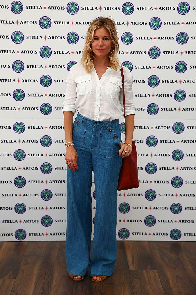 <p>The American Sniper star wore high-waisted, flared trousers to the Stella Artois event during Wimbledon. </p>