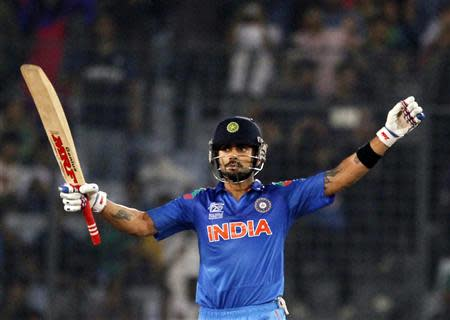 India's Virat Kohli celebrates after India won the semi final match against South Africa in the ICC Twenty20 World Cup in Dhaka