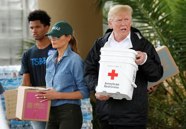 <p>President Donald Trump and first lady Melania Trump help volunteers deliver supplies to residents at a relief supply drive-thru during a visit with flood survivors and volunteers in the aftermath of Hurricane Harvey in Houston, Texas, Sept. 2, 2017. (Photo: Kevin Lamarque/Reuters) </p>