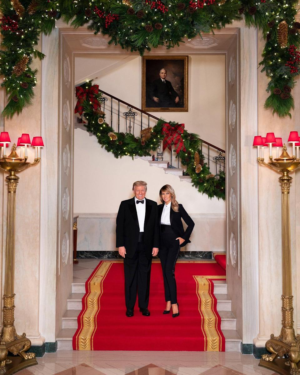 President Donald Trump and First Lady Melania Trump in their official 2020 Christmas portrait, on the Grand staircase of the White House in Washington.