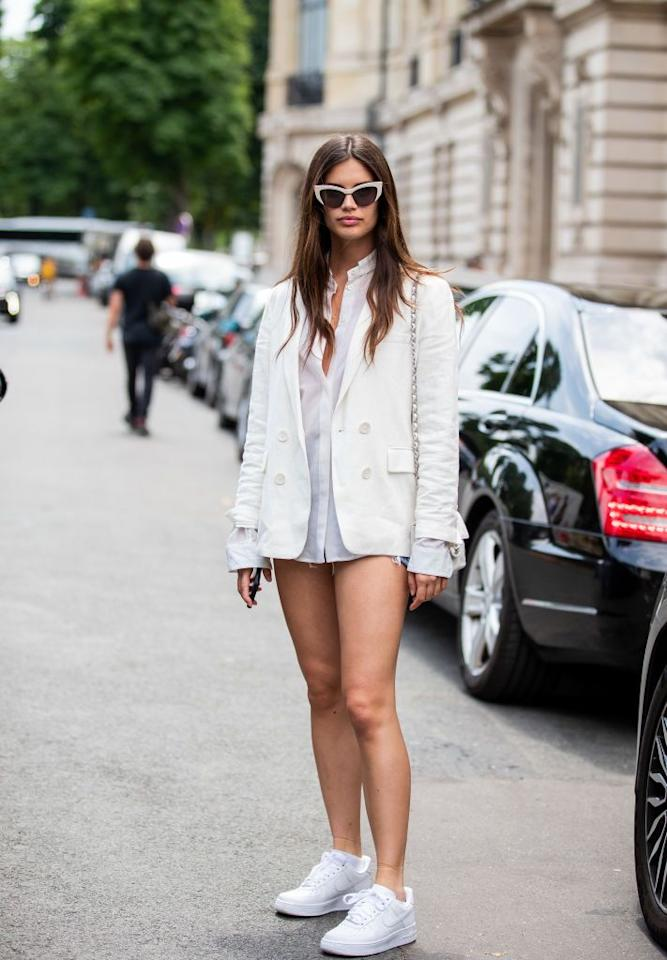 <p>The model's off-duty look paired a white blazer over a button down and denim cutoffs. </p>