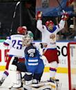 Russia forward Sergei Shirokov, right, celebrates a score as Finland goaltender Pekka Rinne (35) reacts during the gold medal match between Russia and Finland at the Ice Hockey World Championship in Minsk, Belarus, Sunday, May 25, 2014. (AP Photo/Darko Bandic)