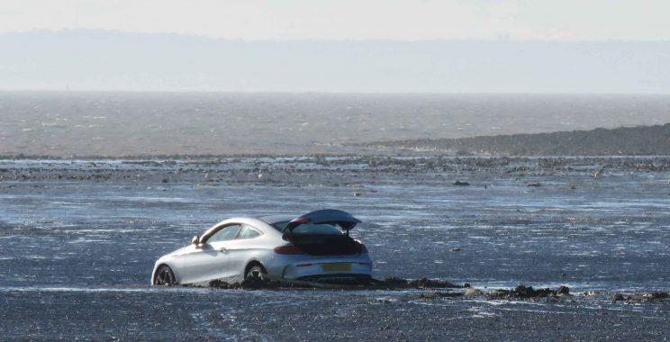 The Mercedes became stranded at Burnham-on-Sea in Somerset. (SWNS)