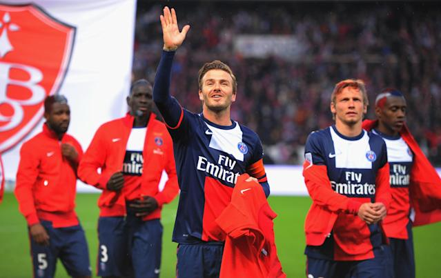 PARIS, FRANCE - MAY 18: David Beckham of PSG waves to his family during the Ligue 1 match between Paris Saint-Germain FC and Stade Brestois 29 at Parc des Princes on May 18, 2013 in Paris, France. (Photo by Michael Regan/Getty Images)