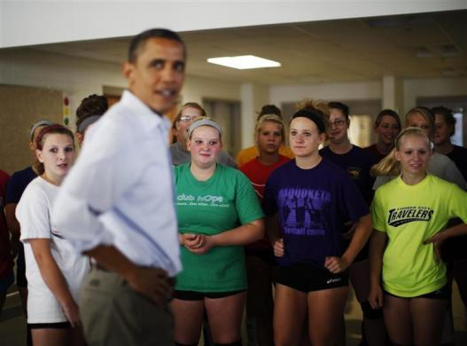 President Barack Obama meets members of the girls junior volleyball team at Maquoketa High School in Iowa, August 16, 2011.