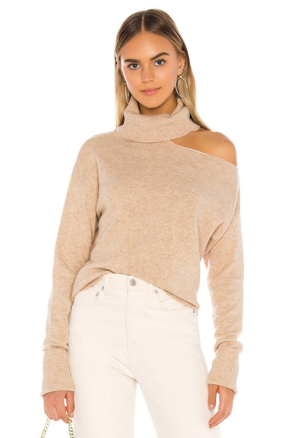 <p>We're very into the cutout on this <span>Paige Raundi Sweater</span> ($258).</p>