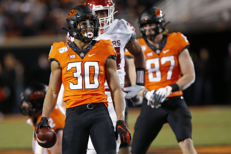 Oklahoma State running back Chuba Hubbard (30) celebrates after a carry against Oklahoma in the first half of an NCAA college football game in Stillwater, Okla., Saturday, Nov. 30, 2019. (AP Photo/Sue Ogrocki)