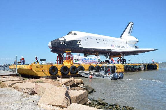 A high-fidelity space shuttle mockup arrives at a Houston dock on June 1, 2012, via barge to be delivered to Space Center Houston and placed on public display.