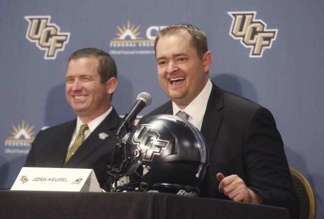 Josh Heupel (R) replaced Scott Frost as Central Florida's head coach. Will Heupel keep UCF's undefeated run going? (AP file photo)