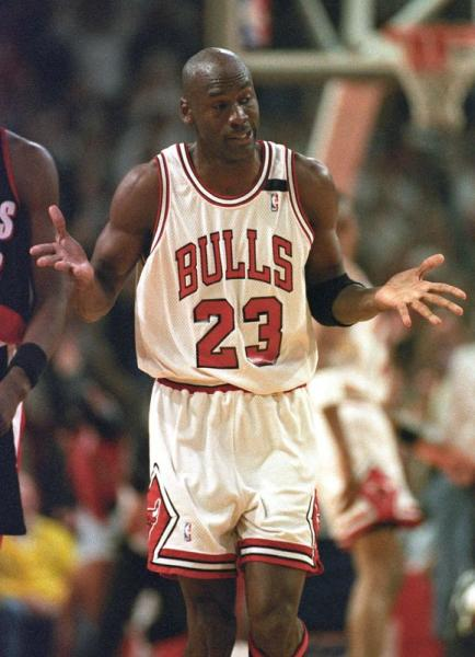 FILE PHOTO: Chicago Bulls' Michael Jordan shrugs after sinking a record sixth three-pointer during the first half of the first game of the NBA Finals against Portland Trail Blazers in Chicago.
