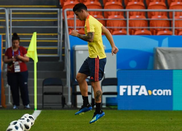 Colombia have injury concerns as they prepare to face Japan, in the form of Brazil top scorer James Rodriguez, with the Bayern midfielder nursing a calf strain (AFP Photo/JUAN BARRETO)