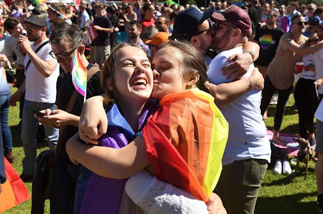 <p>Supporters of the same-sex marriage 'Yes' vote gather to celebrate the announcement in a Sydney park on Nov. 15, 2017. (Photo: William West/AFP/Getty Images) </p>