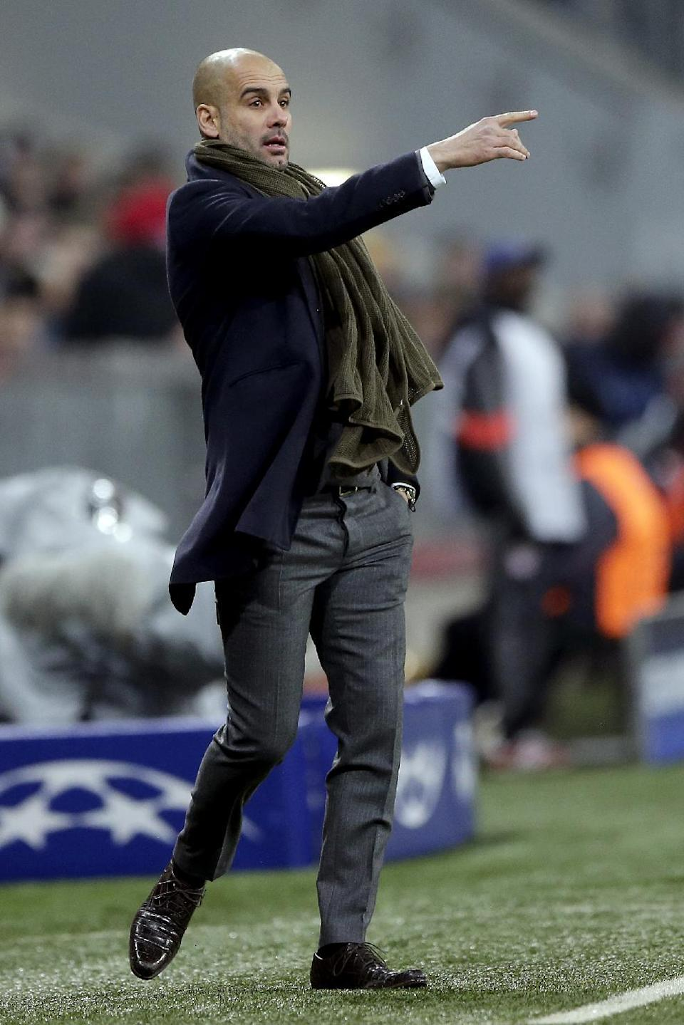 Bayern's head coach Pep Guardiola points during the Champions League group E soccer match between FC Bayern Munich and CSKA Moscow in Munich, Germany, Wednesday, Dec. 10, 2014. (AP Photo/Matthias Schrader)