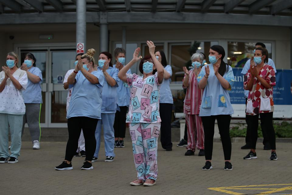 Staff outside Abbeydale Court Care Home in Hamilton clapping to salute local heroes during Thursday's nationwide Clap for Carers initiative to recognise and support NHS workers and carers fighting the coronavirus pandemic.