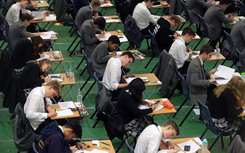 Students sitting an exam - Credit: Gareth Fuller/PA