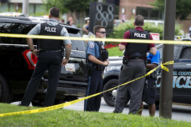 <p>Authorities work the scene after multiple people were shot at a newspaper office building in Annapolis, Md., Thursday, June 28, 2018. (Photo: Jose Luis Magana/AP) </p>