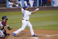 Los Angeles Dodgers' Albert Pujols, right, hits a two-run home run as Arizona Diamondbacks catcher Stephen Vogt watches during the second inning of a baseball game Thursday, May 20, 2021, in Los Angeles. (AP Photo/Mark J. Terrill)
