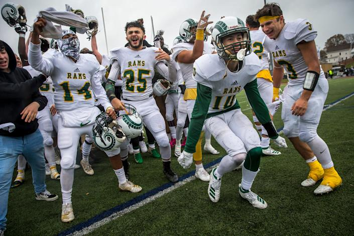 Lynn Classical players celebrate their 22-9 win against Lynn English after the Thanksgiving Day high school football game at Manning Field in Lynn, MA on Nov. 28, 2019.