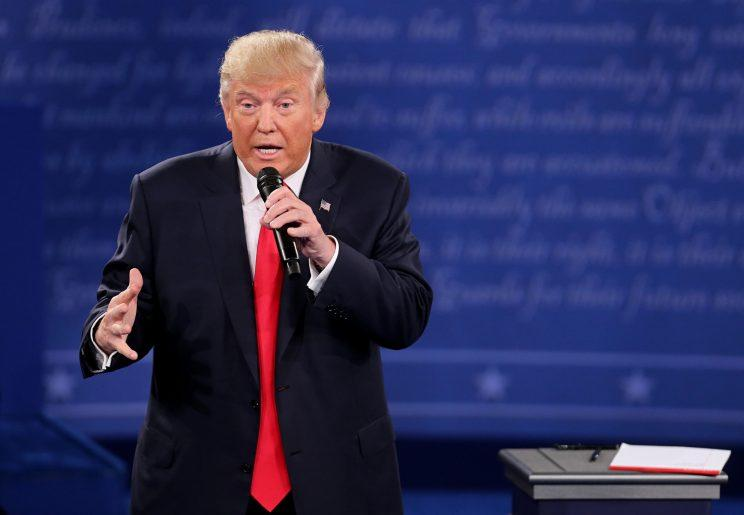Donald Trump, wearing one of his signature long ties, speaks at the second presidential debate, on Oct. 9.