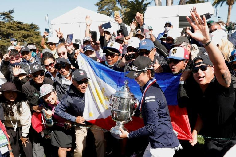 Yuka Saso of the Philippines walks past fans with the Harton S. Semple Trophy after winning the 76th US Women's Open at Olympic Club in San Francisco