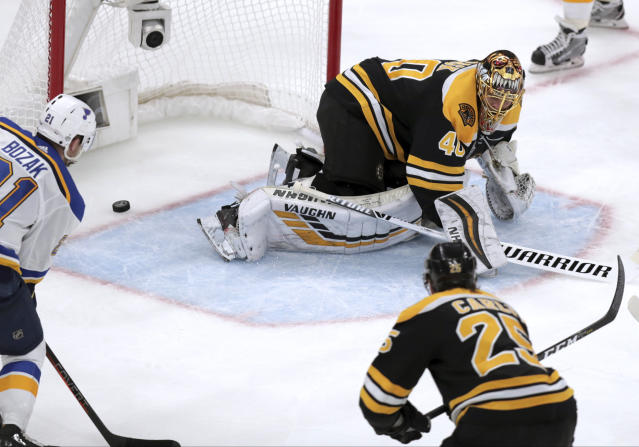 A shot by St. Louis Blues' David Perron, not pictured, crosses the line for a goal behind Boston Bruins goaltender Tuukka Rask, right, of Finland, during the third period in Game 5 of the NHL hockey Stanley Cup Final, Thursday, June 6, 2019, in Boston. (AP Photo/Charles Krupa)
