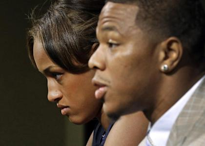 Janay Rice, left, looks on as her husband, Ray Rice, speaks to the media in September. (AP)
