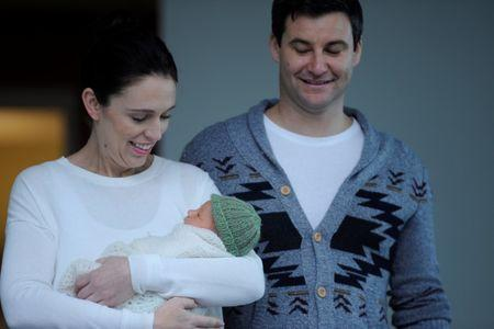 New Zealand Prime Minister Jacinda Ardern carries her newborn baby Neve Te Aroha Ardern Gayford with partner Clarke Gayford as she walks out of the Auckland Hospital in New Zealand, June 24, 2018.        REUTERS/Ross Land