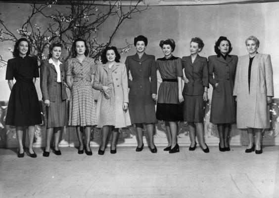 5th March 1945: Models showing the Utility range of women's Spring fashions, at the Fashions Theatre at Selfridges department store in Oxford Street (Photo by Fox Photos/Getty Images)