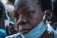 Tears: A woman in Lukodi weeps as she listens to the Dominic Ongwen verdict on the radio