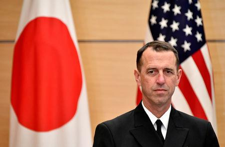 Admiral John Richardson, Chief of U.S. Naval Operations, waits for Japan's Prime Minister Shinzo Abe before their meeting at the Prime Minister's official residence in Tokyo