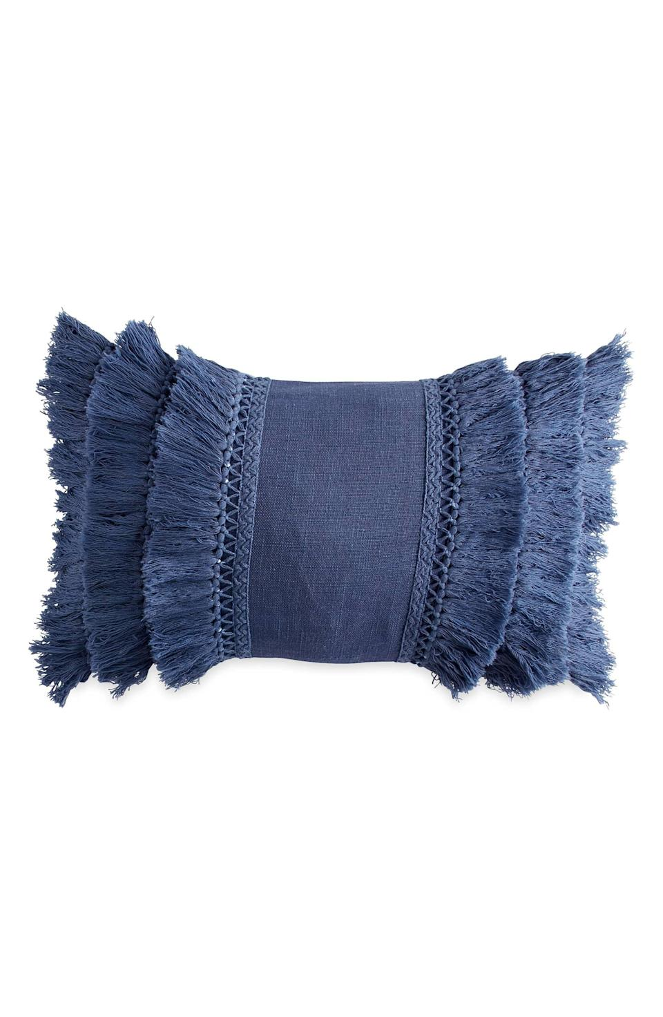 """The whole boho-chic movement may have gone stale, but a touch of subtle fringe-y style can still feel fresh.<br><br><strong>Peri Home</strong> Fringe Pillow, $, available at <a href=""""https://go.skimresources.com/?id=30283X879131&url=https%3A%2F%2Fshop.nordstrom.com%2Fs%2Fperi-home-fringe-pillow%2F4625511"""" rel=""""nofollow noopener"""" target=""""_blank"""" data-ylk=""""slk:Nordstrom"""" class=""""link rapid-noclick-resp"""">Nordstrom</a>"""