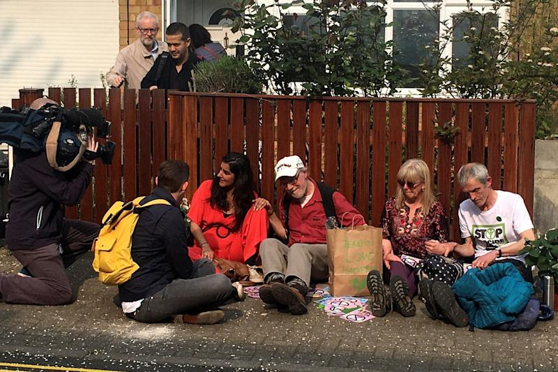 Jeremy Corbyn leaves his home as Extinction Rebellion protesters sit outside (Reuters)