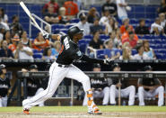 Miami Marlins' Lewis Brinson watches his home run during the third inning of a baseball game against the New York Mets, Friday, June 29, 2018, in Miami. (AP Photo/Wilfredo Lee)