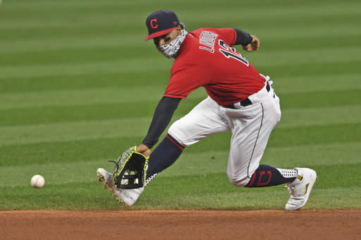 FILE - Cleveland Indians' Francisco Lindor (12) fields the ball in the first inning of Game 1 of an American League wild-card baseball series against the against the New York Yankees in Cleveland, in this Tuesday, Sept. 29, 2020, file photo. The Cleveland Indians have agreed to trade four-time All-Star shortstop Francisco Lindor and pitcher Carlos Carrasco to the New York Mets, a person with direct knowledge of the deal told the Associated Press on Thursday, Jan. 7, 2021. (AP Photo/David Dermer, File)