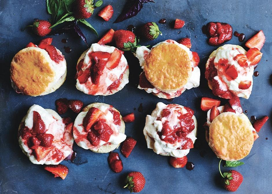 """We love the combination of gently cooked and raw strawberries in this not-too-sweet version of the classic dessert. <a href=""""https://www.bonappetit.com/recipe/strawberry-basil-shortcakes?mbid=synd_yahoo_rss"""" rel=""""nofollow noopener"""" target=""""_blank"""" data-ylk=""""slk:See recipe."""" class=""""link rapid-noclick-resp"""">See recipe.</a>"""