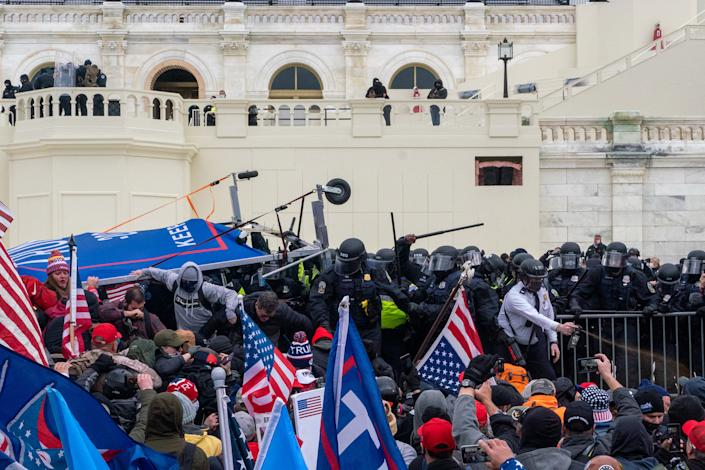 """Pro-Trump rioters clash with police before gaining entry to the U.S. Capitol following an inflammatory speech by President Trump on Jan. 6.<span class=""""copyright"""">Peter van Agtmael—Magnum Photos for TIME</span>"""