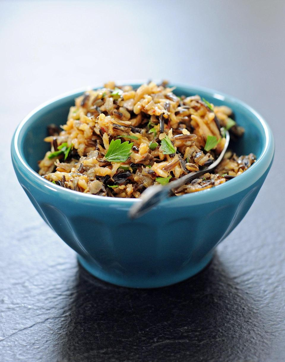"<p>Wild rice might not be quite as popular a stuffing base as cubes of a crusty boule or tender cornbread, but don't discount it quite yet. Made with wild rice, brown rice, mushrooms, and just enough butter and olive oil to make it crave-worthy, it's a worthy contender for your holiday table this year.</p> <p><strong>Get the recipe</strong>: <a href=""https://www.popsugar.com/food/Wild-Rice-Mushroom-Dressing-Recipe-11992017"" class=""link rapid-noclick-resp"" rel=""nofollow noopener"" target=""_blank"" data-ylk=""slk:wild rice stuffing with mushrooms"">wild rice stuffing with mushrooms</a> </p>"