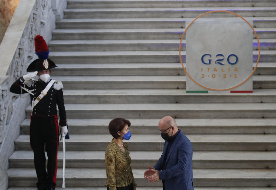 South Korea minister of environment, Han Jeoung-ae is welcomed by Italian Minister for Ecological Transition Roberto Cingolani as she arrives at Palazzo Reale in Naples, Italy, Thursday, July 22, 2021, to take part in a G20 meeting on environment, climate and energy. (AP Photo/Salvatore Laporta)