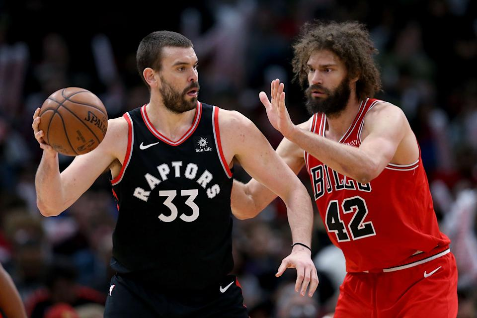 CHICAGO, ILLINOIS - MARCH 30:  Marc Gasol #33 of the Toronto Raptors handles the ball while being guarded by Robin Lopez #42 of the Chicago Bulls in the second quarter at the United Center on March 30, 2019 in Chicago, Illinois. NOTE TO USER: User expressly acknowledges and agrees that, by downloading and or using this photograph, User is consenting to the terms and conditions of the Getty Images License Agreement. (Photo by Dylan Buell/Getty Images)