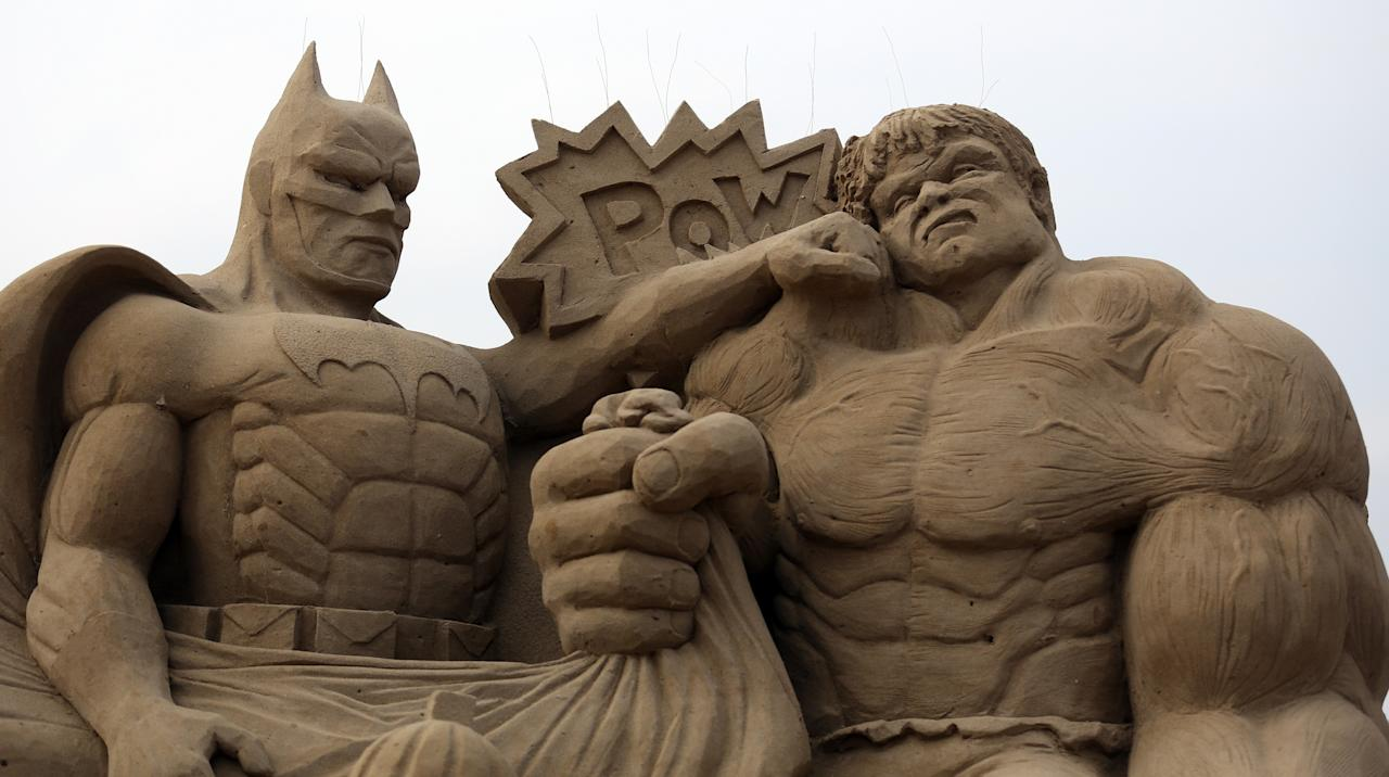 WESTON-SUPER-MARE, ENGLAND - MARCH 26:  Detail of a sand sculpture of Batman and The Incredible Hulk is seen as pieces are prepared as part of this year's Hollywood themed annual Weston-super-Mare Sand Sculpture festival on March 26, 2013 in Weston-Super-Mare, England. Due to open on Good Friday, currently twenty award winning sand sculptors from across the globe are working to create sand sculptures including Harry Potter, Marilyn Monroe and characters from the Star Wars films as part of the town's very own movie themed festival on the beach.  (Photo by Matt Cardy/Getty Images)