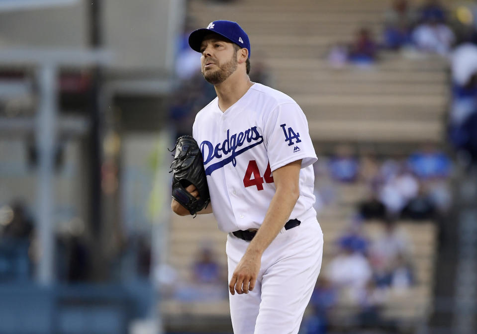 Los Angeles Dodgers' Rich Hill reacts after a pitch during the first inning of the team's baseball game against the San Francisco Giants on Wednesday, June 19, 2019, in Los Angeles. Hill was taken out of the game with an injury before the second inning started. (AP Photo/Mark J. Terrill)