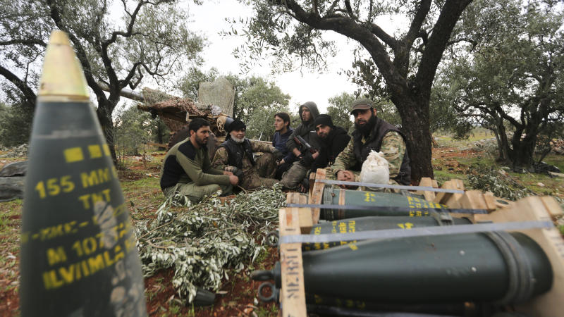 Turkish backed Syrian fighters take a break near the village of Neirab, in Idlib province, Syria, Monday, Feb. 24, 2020. (AP Photo/Ghaith Alsayed)