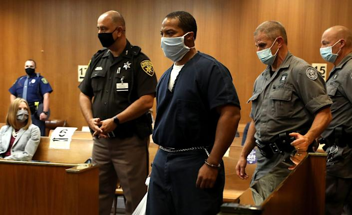 Juwan Deering is escorted into the courtroom of Judge Jeffery Matis at the Oakland County Circuit Court in Pontiac before his hearing on Tuesday, September 21, 2021.