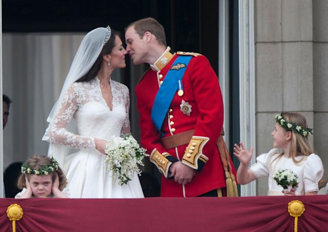 Catherine, Duchess of Cambridge and Prince William, Duke of Cambridge on the balcony at Buckingham Palace. (Photo by Mark Cuthbert/UK Press via Getty Images)