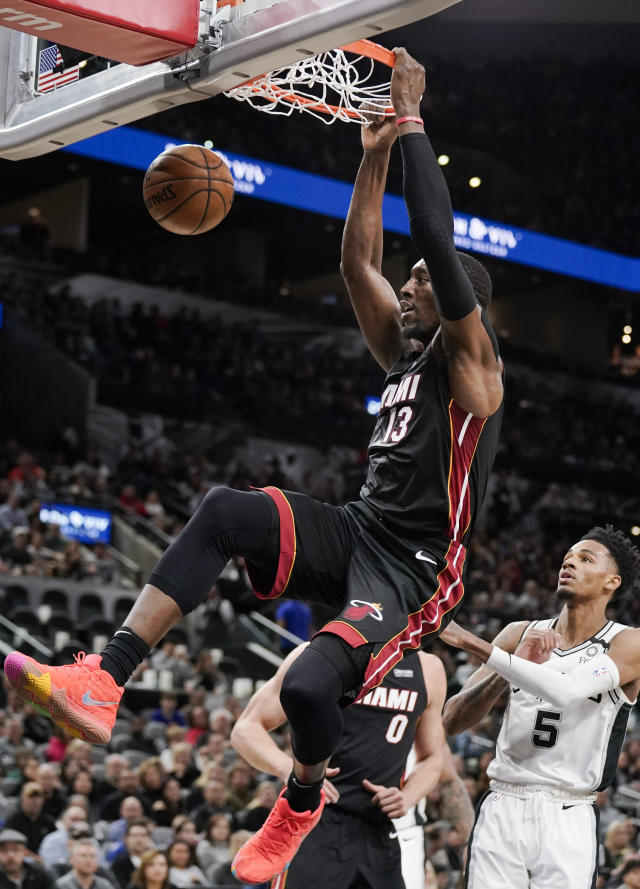 Miami Heat's Bam Adebayo dunks during the first half of an NBA basketball game against the San Antonio Spurs, Sunday, Jan. 19, 2020, in San Antonio. (AP Photo/Darren Abate)