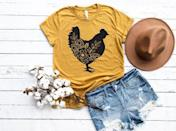 "<p><strong>CDCustomTees</strong></p><p>etsy.com</p><p><strong>$15.99</strong></p><p><a href=""https://go.redirectingat.com?id=74968X1596630&url=https%3A%2F%2Fwww.etsy.com%2Flisting%2F723799595%2Ffloral-chicken-shirt-chicken-shirt-farm&sref=https%3A%2F%2Fwww.countryliving.com%2Flife%2Fg32111109%2Fgifts-for-chicken-lovers%2F"" rel=""nofollow noopener"" target=""_blank"" data-ylk=""slk:Shop Now"" class=""link rapid-noclick-resp"">Shop Now</a></p><p>Comfy and cute, this floral chicken T-shirt will be her favorite top to flaunt while making sure all her chickens are in a row.</p>"