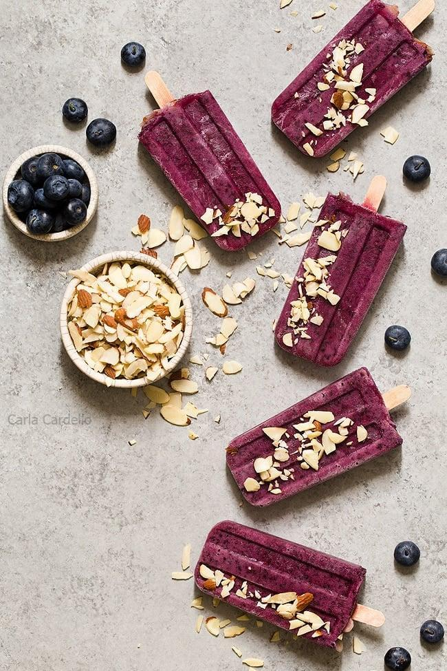 """<p>Antioxidant-rich blueberries are paired with a secret ingredient (almond extract!) for an extra burst of flavor in these tasty pops.</p> <p><strong>Get the recipe:</strong> <a href=""""https://www.chocolatemoosey.com/2017/07/17/blueberry-yogurt-popsicles/"""" class=""""link rapid-noclick-resp"""" rel=""""nofollow noopener"""" target=""""_blank"""" data-ylk=""""slk:blueberry yogurt popsicles"""">blueberry yogurt popsicles</a></p>"""